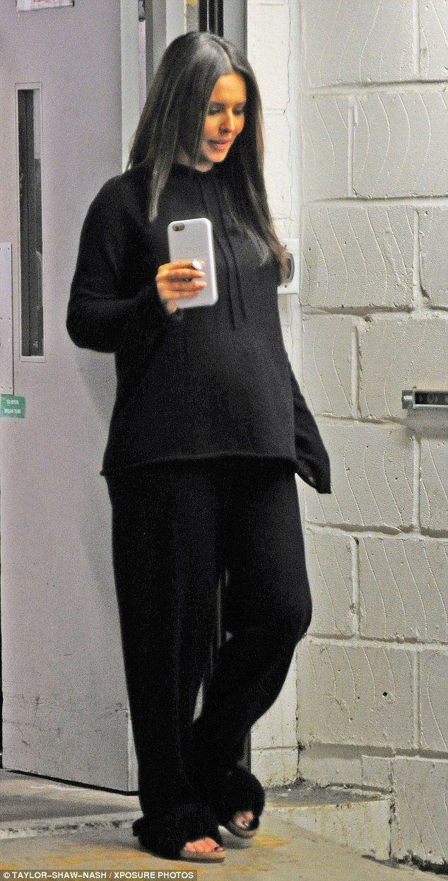Mum to be? Cheryl showed off a bump under comfy black sweats as she stepped out in London on Thursday, amid rumours she is pregnant with her first child