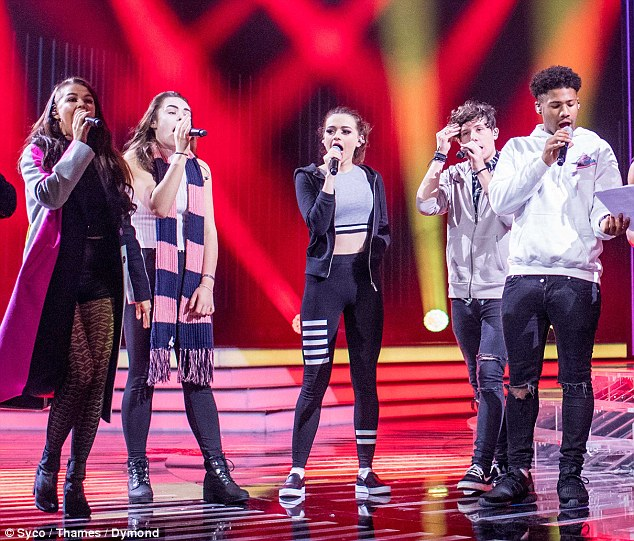 Cute couple: Young lovebirds Emily Middlemas, 18, and Ryan Lawrie, 20, put on an united front at the X Factor rehearsals at Fountain Studios in London on Friday