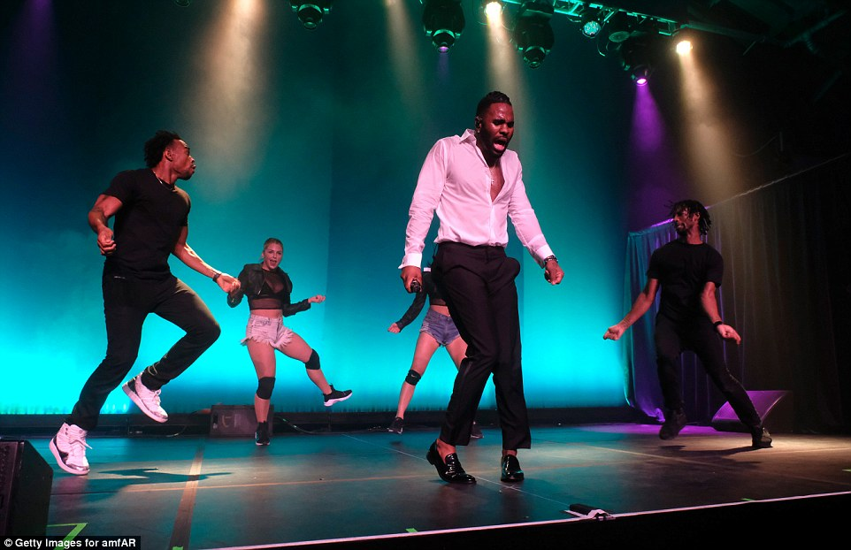 The night's entertainment: The energetic singer showed off his moves with his backing dancers