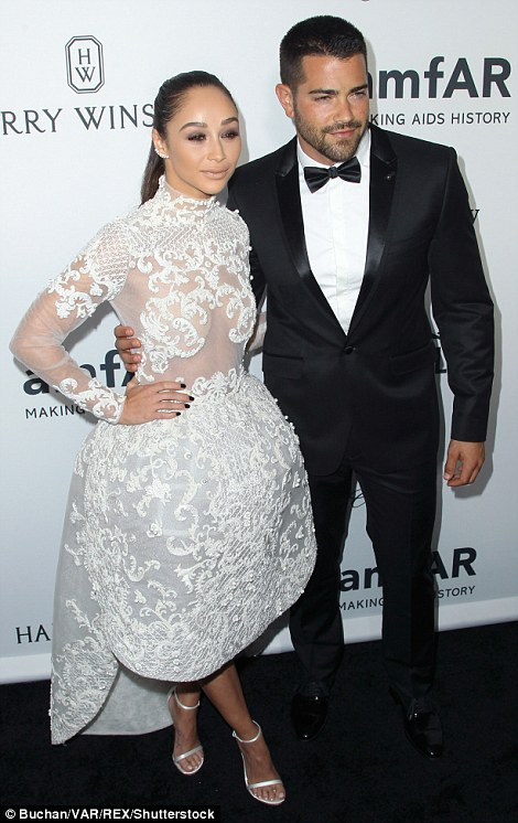 Glam couple: Cara and Jesse looked every inch the stylish couple in their party looks as they posed for pics