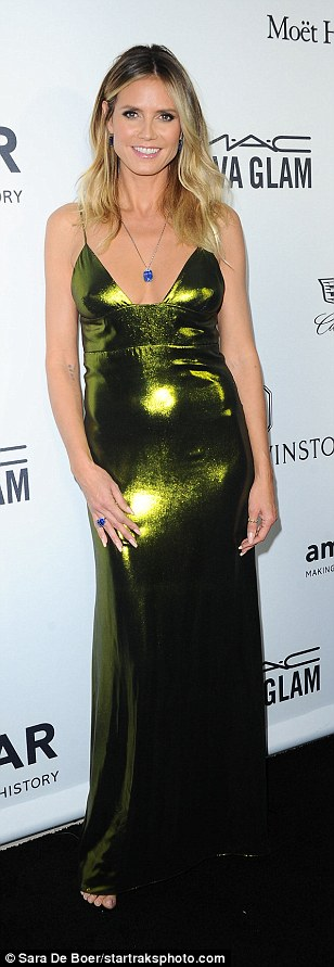 Looking like a million bucks!Heidi Klum cut another unforgettable figure in a slinky green dress with a plunging neckline at the amfAR Inspiration Gala in Hollywood on Thursday night