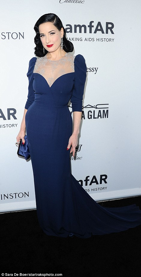 Beautiful in blue! Dita Von Teese cut a super glam figure in her royal blue, floorlength gown with a silver embellished neckline