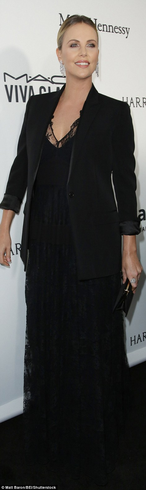 Vampy: Charlize Theron worked a modest black gown with a lace neckline teamed with a blazer