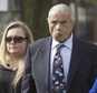 """FILE ? In this Nov. 2, 2015, file photo, former professional wrestler Jimmy """"Superfly"""" Snuka, right, arrives for his formal arraignment at the Lehigh County Courthouse in Allentown, Pa. In a decision filed Tuesday, Jan. 3, 2017, a Pennsylvania judge dismissed the murder case against Snuka in the 1983 death of his girlfriend Nancy Argentino, saying Snuka is not competent to stand trial on counts including third-degree murder. Snuka's attorney told a judge in December 2016 that his client is in hospice care in Florida and has six months to live. (Michael Kubel/The Morning Call via AP, File)"""