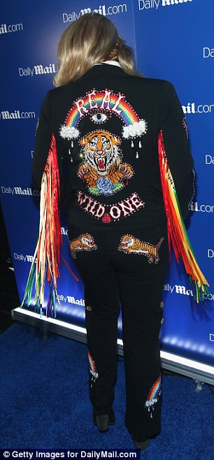Animal instinct: On the back of her rainbow tassled jacket she had the legend Real Wild One and a picture of a tiger along with two pouncing tigers on her behind