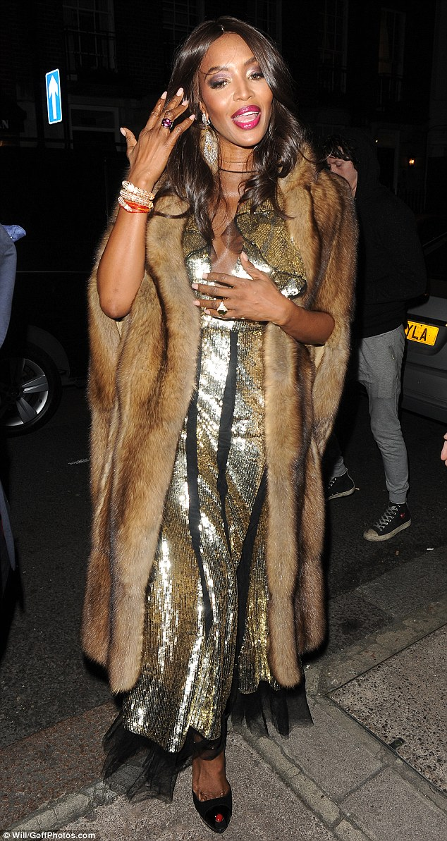 Here she comes: Naomi, 46, wore a metallic gown with her fur as shearrived at upmarket Mayfair club Mark's ahead of an exclusive party held on behalf of fashion photographers Mert and Marcus