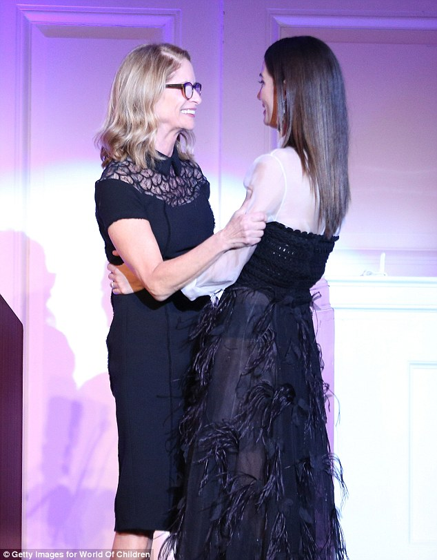 Two of a kind: Lily was embraced byBoard of Governors member Ann O'Malley