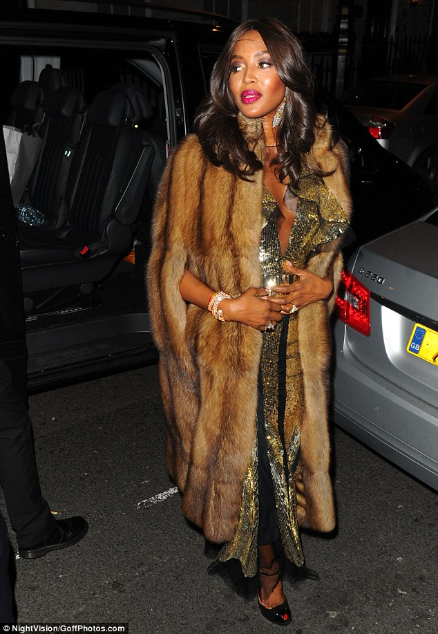 Making her entrance: Naomi has been seen in fur on occasion since her 1994 campaign