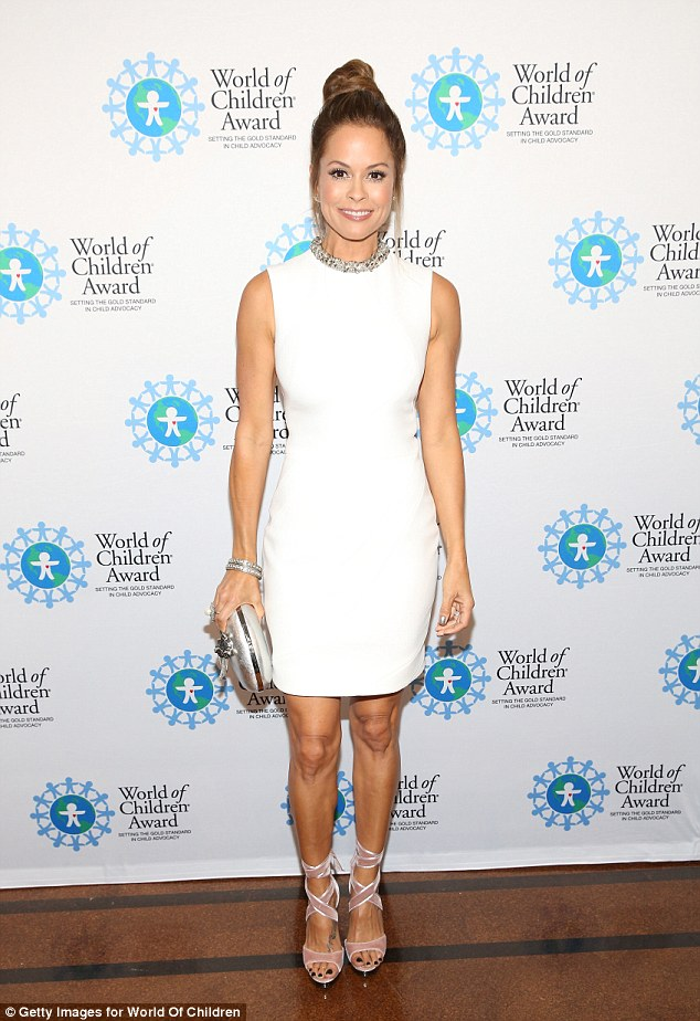 White hot:Brooke went for a less is more approach wearing a simple white shift dress which highlighted her curves