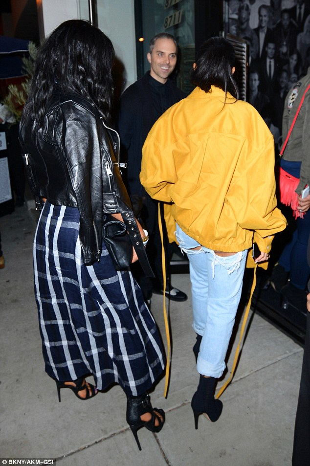 Cheeky! Karrueche offered a cheeky glimpse at her behind. Slipping her slim pins into loose fitting jeans, the garment featured two sizable rips just below her peachy posterior