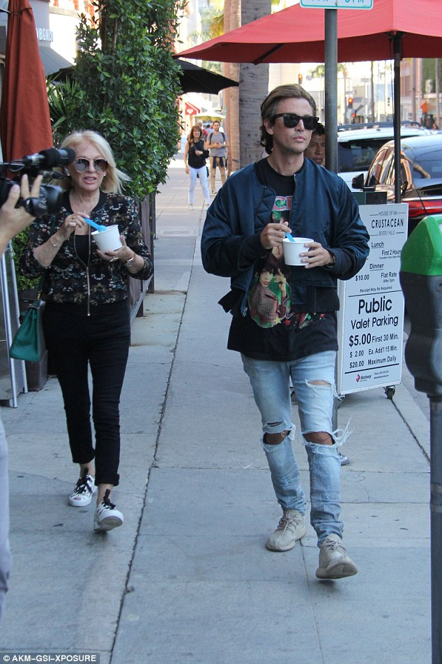 He looks like the Lord:Cheban wore heavily ripped jeans that looked borrowed from Scott Disick as well as a statement T-shirt and a blue bomber jacket