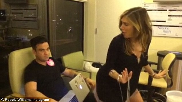 Goofing around:Robbie went onto share videos showing the pair of them dancing in their hospital room as well as him singing his hits as Ayda had contractions