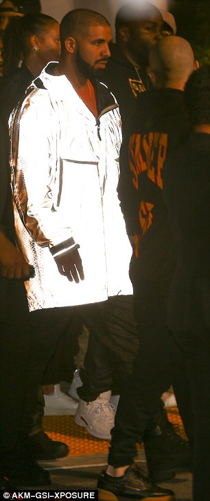 In a flash:The Canadian rapper was a sight to see as he wore a completely reflective 3M jacket for the occasion