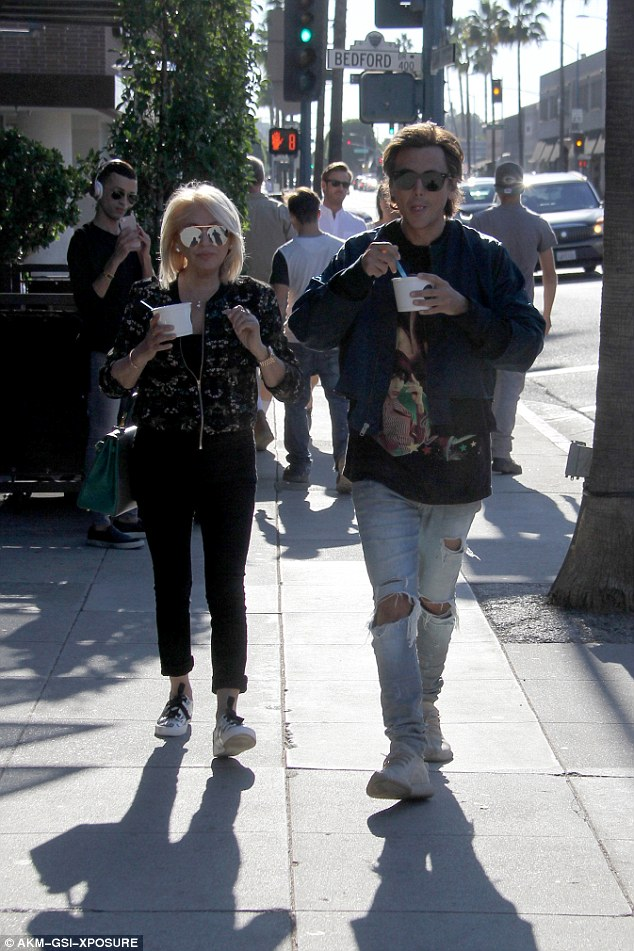 Hip mom:Galina was stylish in a zip-up jacket, skinny black jeans and sneakers