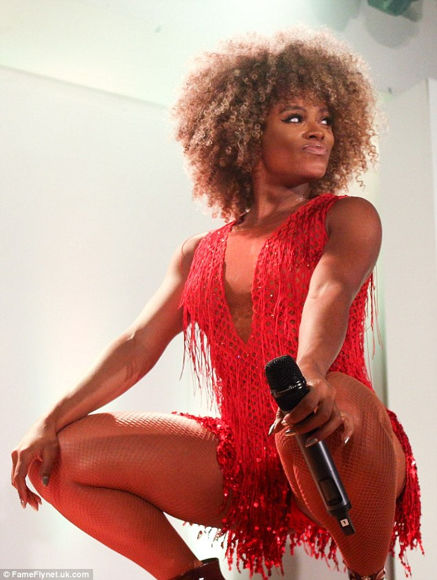 Seeing red: Fleur East got into the festive spirit on Thursday as she performed at the Trafford Centre's Christmas Lights switch on
