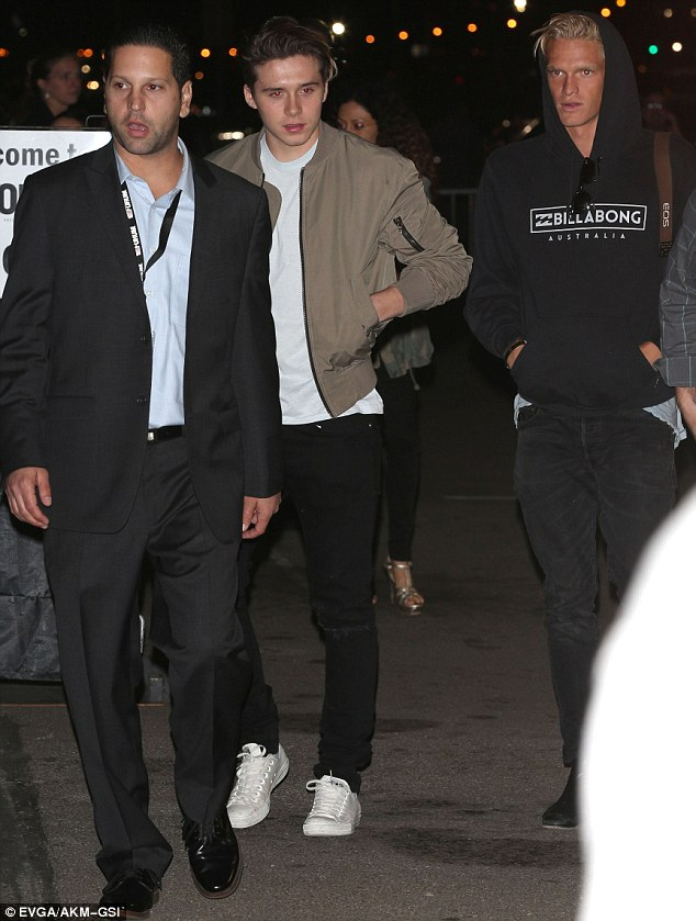 Pals: Cody, 19, looked equally chilled in black jeans and a Billabong hoody, teamed with a pair of leather boots