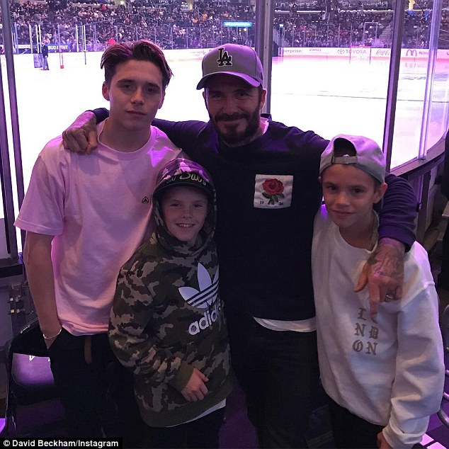 Quick turnaround: Beckham on Wednesday took his three sons(left to right) Brooklyn, Cruz, 11, and Romeo to a hockey game in Los Angeles