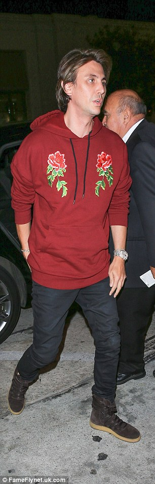 Later that night Cheban stopped by Catch restaurant.  The FoodGod wore a fancy sweatshirt with two embroidered roses. He added skinny black jeans and black sneakers