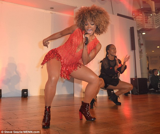 Busting some moves: Fleur was joined by two dancers who sported black fishnet outfits