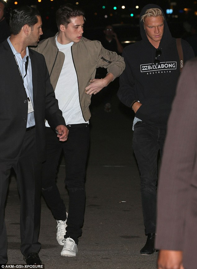 On the move: Brooklyn Beckham preferred to spend Wednesday night away from his clan as he hit the town with pal Cody Simpson