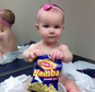 In this photo provided by the Carrie Stevenson, her daughter Estelle holds a bag of peanut snacks in her pediatrician¿s office at age nine-months, in Columbus, Ohio. Most babies should start eating peanut-containing foods well before their first birthday, say guidelines released Thursday that aim to protect high-risk tots and other youngsters, too, from developing the dangerous food allergy. The new guidelines from the National Institutes of Health mark a shift in dietary advice, based on landmark research that found early exposure dramatically lowers a baby's chances of becoming allergic. (Carrie Stevenson via AP)