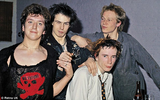 John (centre back) with his band members in the Sex Pistols in 1977
