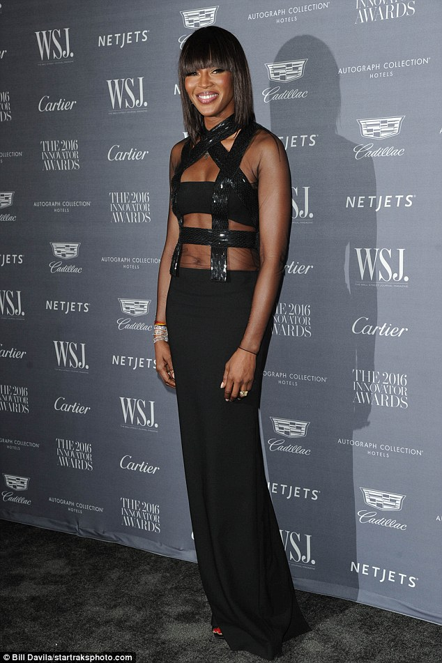 Toned: The 46-year-old supermodel left little to the imagination as she stepped out in a revealing cutaway dress