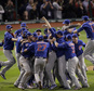 FILE - In this Nov. 3, 2016, file photo, the Chicago Cubs celebrate after Game 7 of the Major League Baseball World Series against the Cleveland Indians, in Cleveland. The World Series champion Chicago Cubs have accepted President Barack Obama?s invitation and will visit the White House on Monday, Jan. 16, 2017. White House press secretary Josh Earnest said Wednesday that Obama is ?really looking forward to it? and that any sports fan could appreciate ?the historic run that the Chicago Cubs had through the playoffs and to a World Series title this year.? (AP Photo/Charlie Riedel, File)