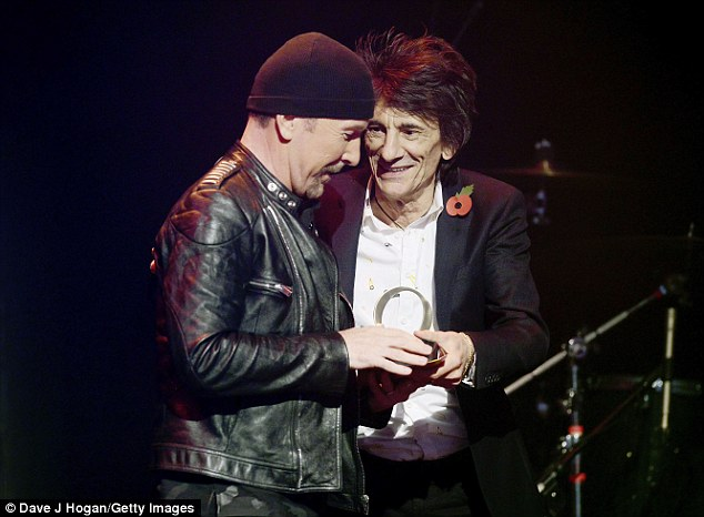 Honoured: During a chat with Q at the show Ronnie said of his fellow rocker: 'I was honoured to get the call to come and present him. I would get out of bed to present him, so I did'