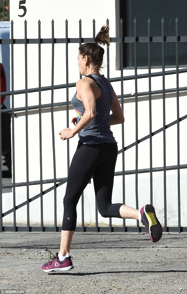 Outdoor workout: She put on a sporty display as she ran in the neighbourhood