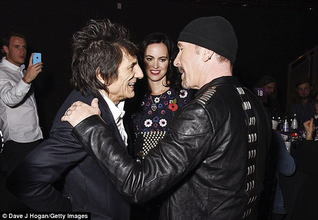 Good to see you: The two rock icons were on good form and following an impromptu drum solo from Ronnie, The Edge accepted his award