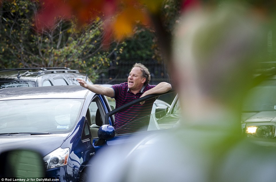 Not having it: An angry driver yells at workers as preparations are underway in DC