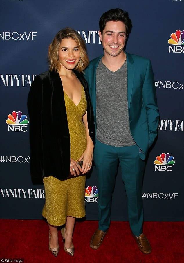 Dressed to impress: The slinky lime green number ensured all focus was on her assets as it skimmed her womanly physique as she posed with actor Ben Feldman