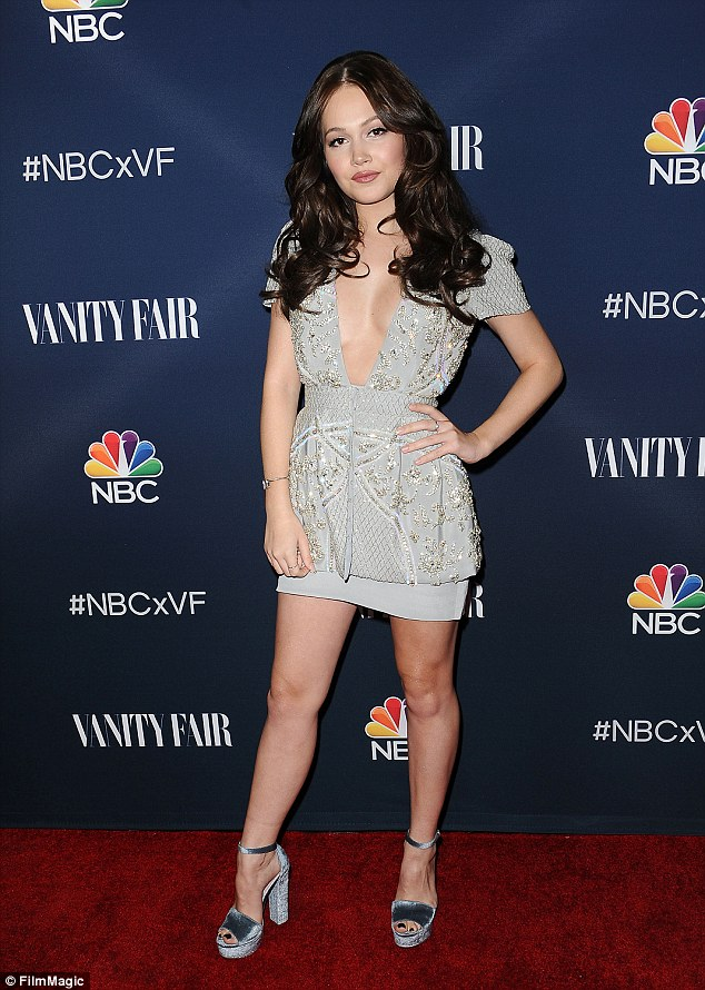 Silver lining: Actress Kelli Berglund pulled out all the stops in a plunging mini-dress which showed off her perky cleavage and toned legs