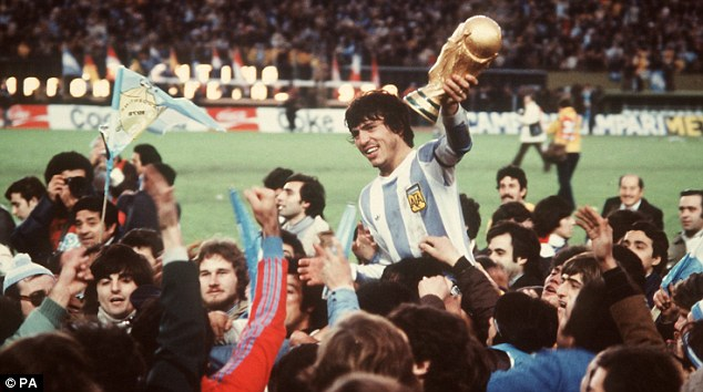 Champions: Argentina captain Daniel Passarella holds the Jules Rimet trophy after his team won the 1978 World Cup final 3-1 against the Netherlands