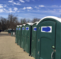 A row of portable restrooms, with the name ¿Don¿s Johns¿ covered up, is seen on Capitol Hill in Washington, Friday, Jan. 13, 2017. Virginia-based Don¿s Johns calls itself the Washington area¿s top provider of portable toilet rentals, but the name apparently strikes too close to home for inaugural organizers. Workers have placed blue tape over the brand name on dozens of portable restrooms installed near the Capitol for the inauguration. (AP Photo/Matthew Daly)