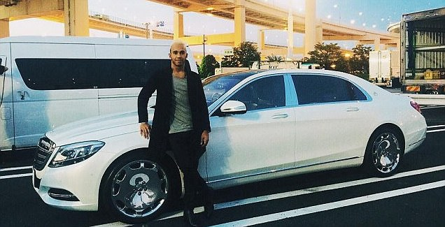 Lewis Hamilton poses with his 'new whip'... a £165,000 Mercedes Maybach as he prepares for