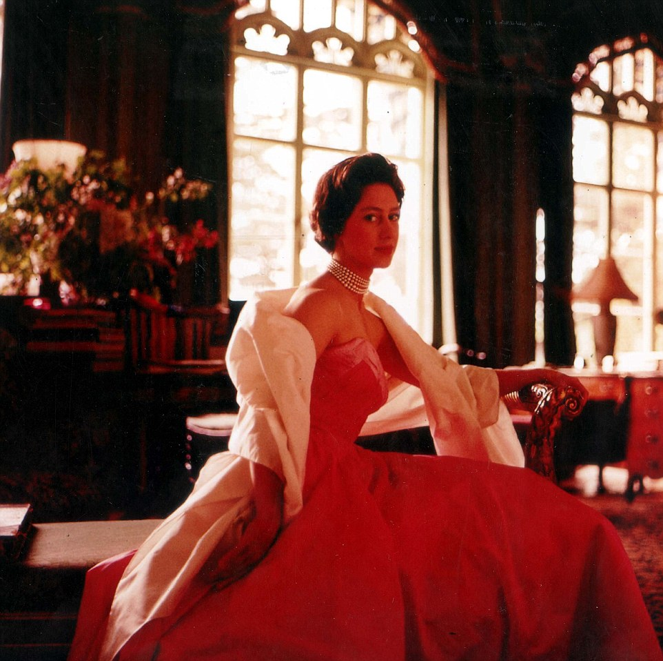 In this intimate photograph the photographer captures his former wife posing in a ball gown in their royal residence