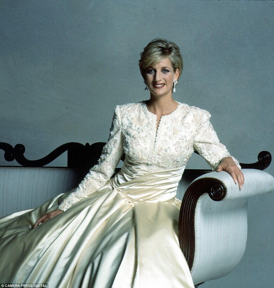 This photo sees Diana pose in one of her favourite designer Catherine Walker's dress for the late photographer in 1992