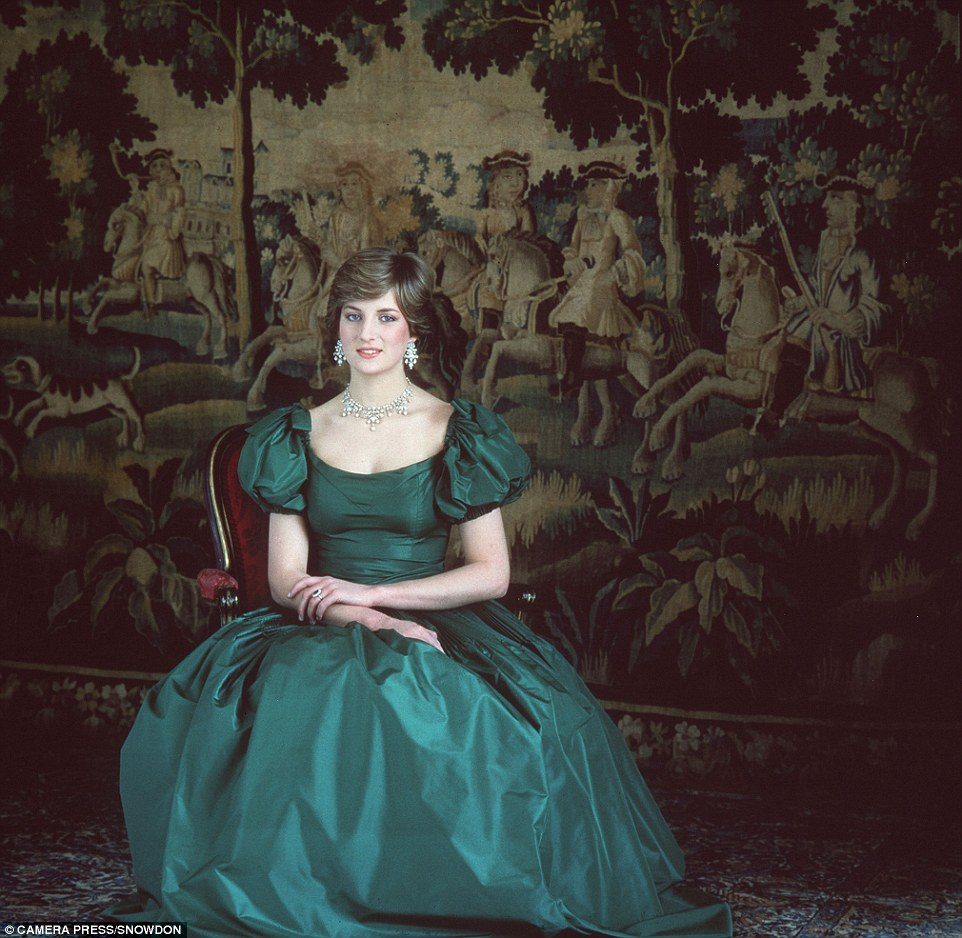 Diana poses in an elegant green dress shortly before her wedding to Prince Charles in July 1981
