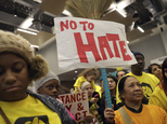 """Demonstrators gather for a rally supporting immigrant rights,  Saturday, Jan. 14, 2017 in Chicago. Immigrant rights advocates are planning demonstrations across the country in what they're calling a """"first salvo"""" against President-elect Donald Trump's pledged hard line on immigration.   (Abel Uribe/Chicago Tribune via AP)"""