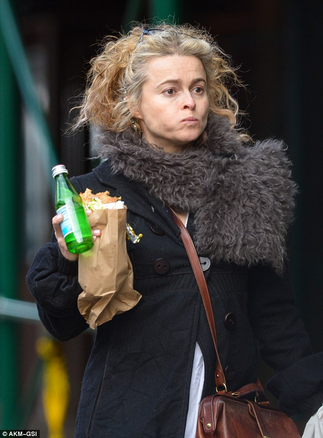 Golden gal: Helena kept her curly golden blonde locks in place with her black frame glasses as she soaked up the sights and sounds of the city, while holding a plastic carrier bag and water bottle in her hands
