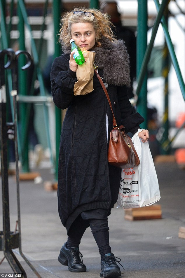 Eating out: Helena Bonham Carter enjoyed a deserved bite out in the Big Apple as she fuelled up on a enticing sandwich in New York on Friday