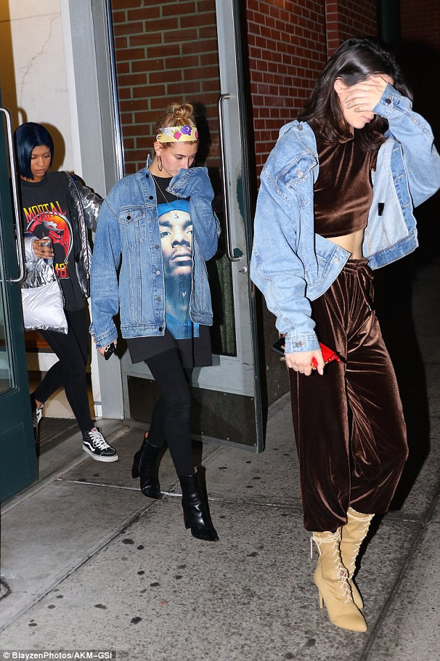 Following the leader: Hailey was rocking an equally casual ensemble in an oversized denim jacket, baggy T-shirt and leather ankle boots