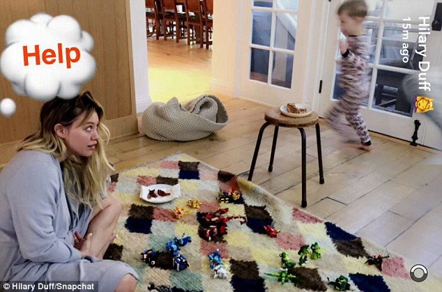 Help!:In another hilarious shot, Hilary is seen warily eyeing her son, who runs around excitedly