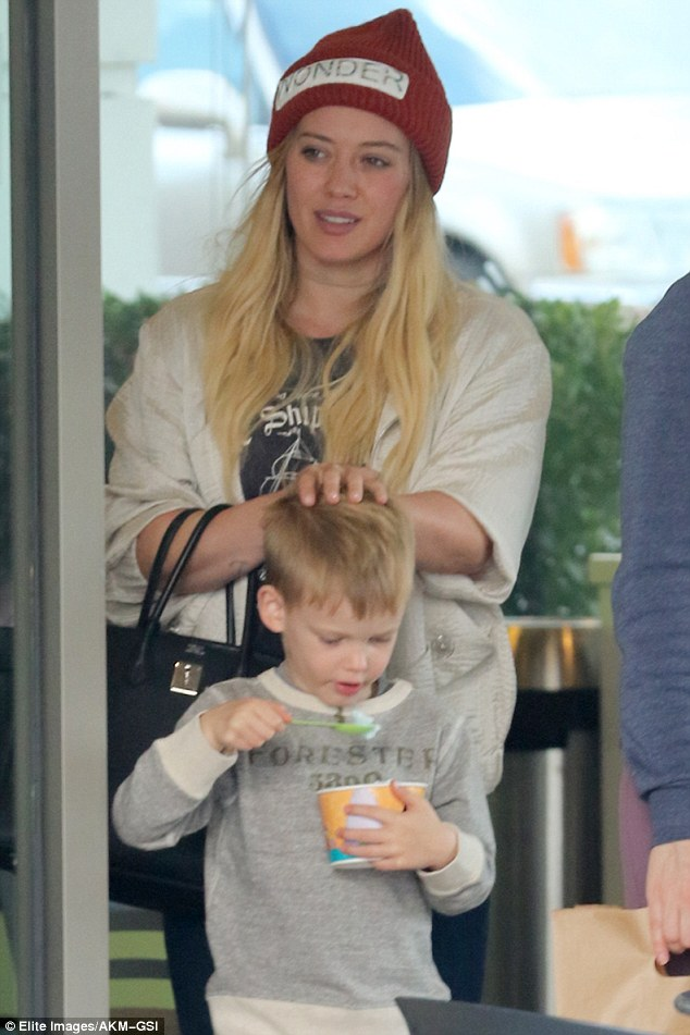 Recovered? The 29-year-old actress was seen treating her son to frozen yogurt after the duo were caught sick this week