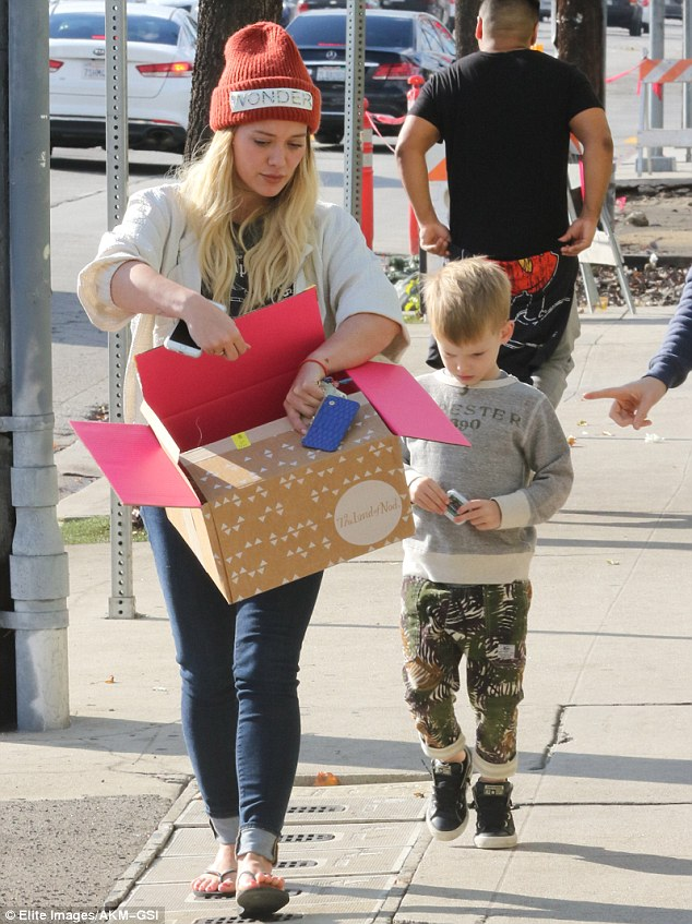 Retail therapy! The mother-and-son duo also seemed to fit in a round of shopping as the actress carried a box from the children's furniture and decor store, The Land of Nod