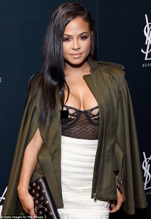 Not shy: One day later, Christina hit the red carpet for YSL's Beauty Club Party at the Ace Hotel in Los Angeles; the lace bodysuit suit exposed her nipple; seen on Tuesday