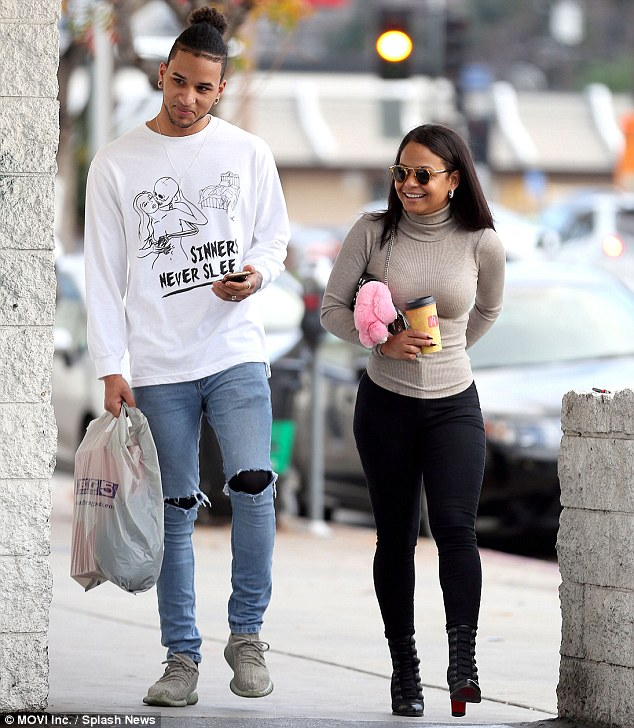 Staying warm: The actress stepped out wearing the fitted winter top with skintight leggings and Christian Louboutin booties