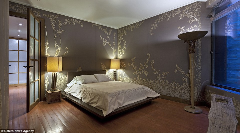 Silk: The wallpaper in one of the bedrooms features beautifully ornate grey and white detail
